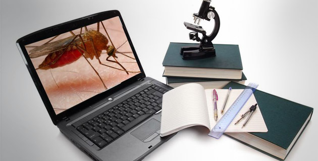 Laptop, microscope, books and others tools for university education